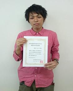 医歯薬学総合研究科博士前期課程2年生の西村 光洋君
